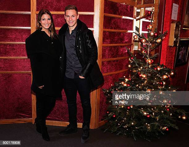 Joshua Kimmich of FC Bayern Muenchen poses for a photo with his girlfriend Lina Meyer during the FC Bayern Muenchen Christmas Party at Schuhbecks...