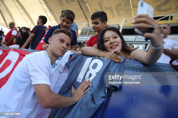 Joshua Kimmich of FC Bayern Muenchen poses for selfies with Bayern Muenchen supporters after a FC Bayern Muenchen training session at Dignity Health...