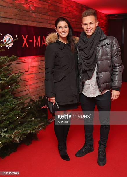 Joshua Kimmich of FC Bayern Muenchen poses with his partner Lina Meyer as they arrive for the club's Christmas party at H'ugo's bar on December 10...