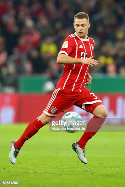 Joshua Kimmich of FC Bayern Muenchen runs with the ball during the DFB Cup match between Bayern Muenchen and Borussia Dortmund at Allianz Arena on...