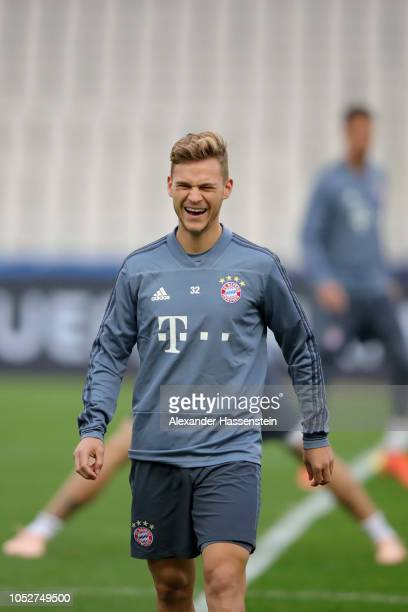 Joshua Kimmich of FC Bayern Muenchen smiles during a training session ahead of their UEFA Champions League Group E match against AEK Athens at Athens...
