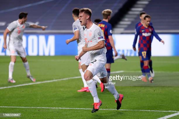 Joshua Kimmich of FC Bayern Munich celebrates after scoring his team's fifth goal during the UEFA Champions League Quarter Final match between...