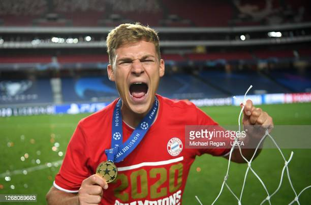 Joshua Kimmich of FC Bayern Munich celebrates following his team's victory in the UEFA Champions League Final match between Paris SaintGermain and...