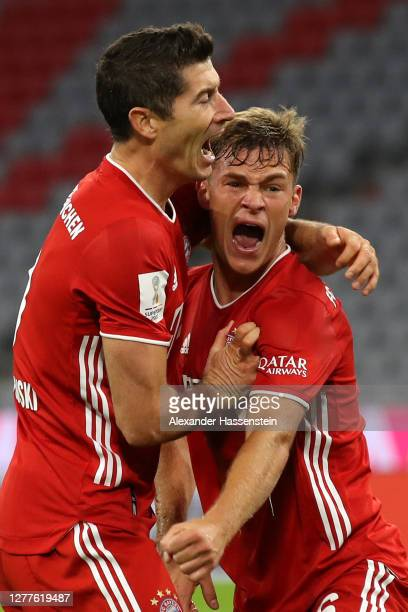 Joshua Kimmich of FC Bayern Munich celebrates with Robert Lewandowski after scoring his sides third goal during the Supercup 2020 match between FC...