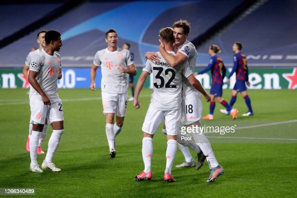 Joshua Kimmich of FC Bayern Munich celebrates with teammate Leon Goretzka after scoring his team's fifth goal during the UEFA Champions League...