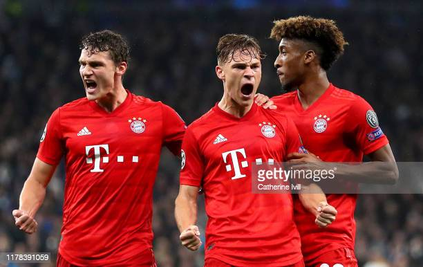 Joshua Kimmich of FC Bayern Munich celebrates with teammates Benjamin Pavard and Kingsley Coman after scoring his team's first goal during the UEFA...