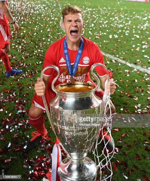 Joshua Kimmich of FC Bayern Munich celebrates with the UEFA Champions League Trophy following his team's victory in the UEFA Champions League Final...