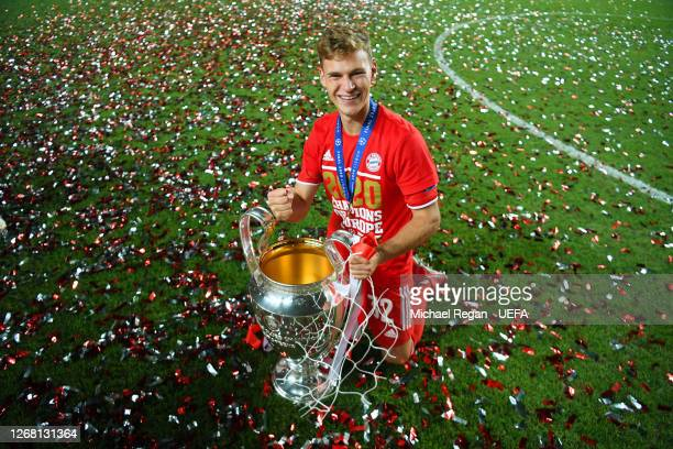 Joshua Kimmich of FC Bayern Munich celebrates with the UEFA Champions League Trophy following his team's victory in the UEFA Champions League Final...