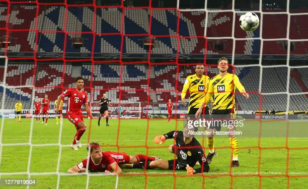 Joshua Kimmich of FC Bayern Munich scores his sides third goal during the Supercup 2020 match between FC Bayern Muenchen and Borussia Dortmund at...
