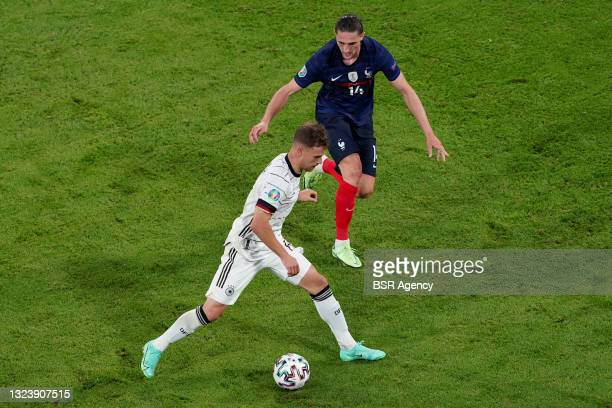 Joshua Kimmich of Germany, Adrien Rabiot of France during the UEFA Euro 2020 match between France and Germany at Allianz Arena on June 15, 2021 in...