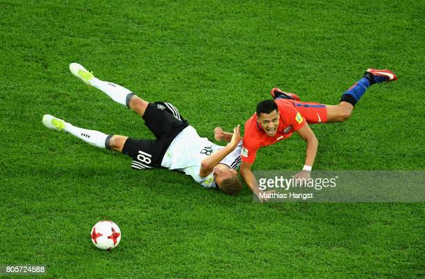 Joshua Kimmich of Germany and Alexis Sanchez of Chile colide during the FIFA Confederations Cup Russia 2017 Final between Chile and Germany at Saint...