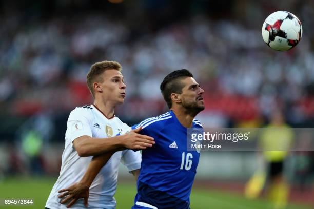 Joshua Kimmich of Germany and Danilo Rinaldi of San Marino battle for possessionduring the FIFA 2018 World Cup Qualifier between Germany and San...