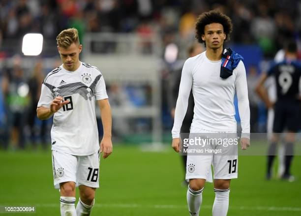 Joshua Kimmich of Germany and Leroy Sane of Germany look dejected following their sides defeat in the UEFA Nations League A group one match between...