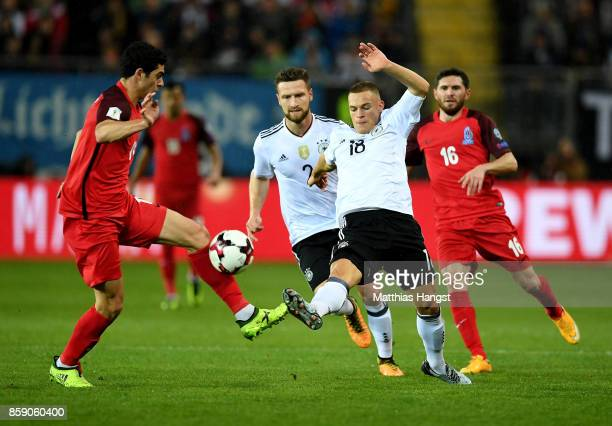 Joshua Kimmich of Germany and Ramil Sheydaev of Azerbaijan battle for the ball during the FIFA 2018 World Cup Qualifier between Germany and...