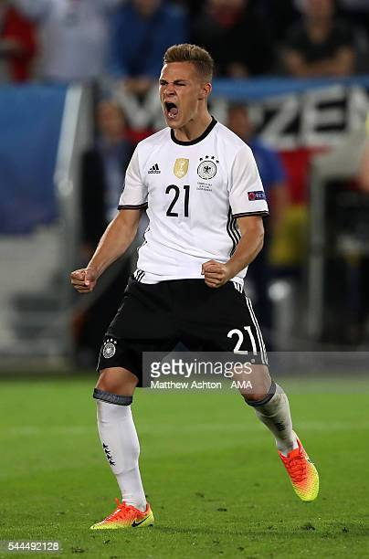 Joshua Kimmich of Germany celebrates after scoring a penalty during the penalty shoot-out during the UEFA Euro 2016 quarter final match between...