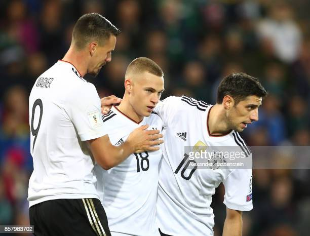 Joshua Kimmich of Germany celebrates scoring the third goal with Lars Stindl and Sandro Wagner during the FIFA 2018 World Cup Qualifier between...