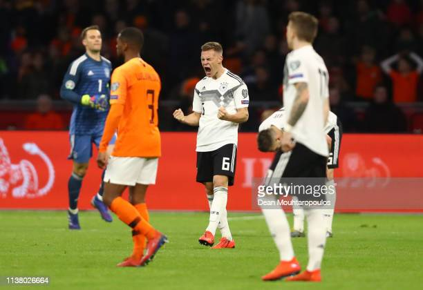 Joshua Kimmich of Germany celebrates victory after the 2020 UEFA European Championships Group C qualifying match between Netherlands and Germany at...