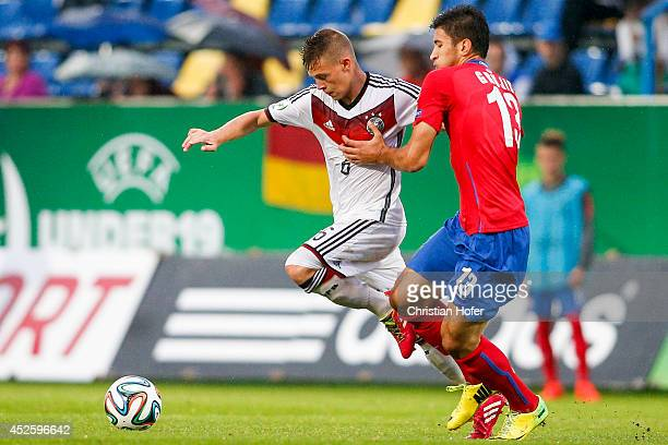 Joshua Kimmich of Germany competes for the ball with Marko Grujic of Serbia during the UEFA Under19 European Championship match between U19 Germany...