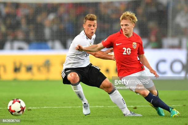 Joshua Kimmich of Germany fights for the ball with Mats Moller Daehli of Norway during the FIFA 2018 World Cup Qualifier between Germany and Norway...