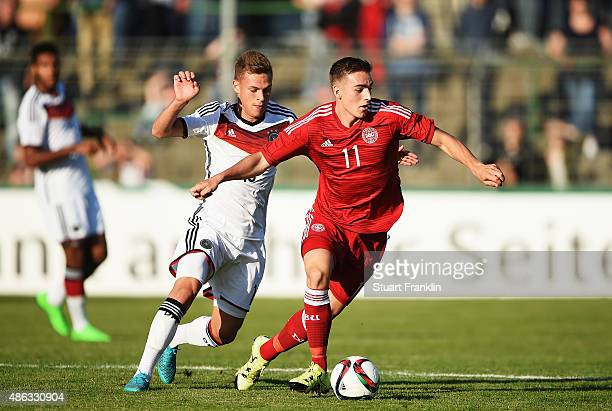Joshua Kimmich of Germany is challenged by Caspar Neilsen of Denmark during the International friendly match between U21 Germany and U21 Denmark at...