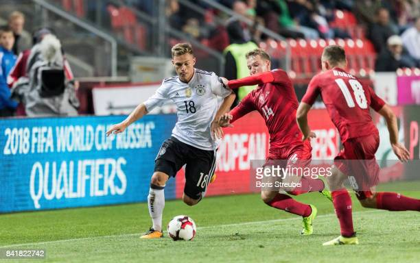 Joshua Kimmich of Germany is challenged by players of Czech Republic during the FIFA 2018 World Cup Qualifier between Czech Republic and Germany at...