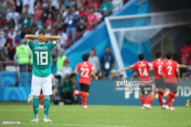Joshua Kimmich of Germany looks dejected as Korea Republic celebrate during the 2018 FIFA World Cup Russia group F match between Korea Republic and...