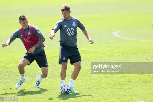Joshua Kimmich of Germany plays the ball with team mate Toni Kroos during a training session of team Germany at the team Germany EURO2020 training...