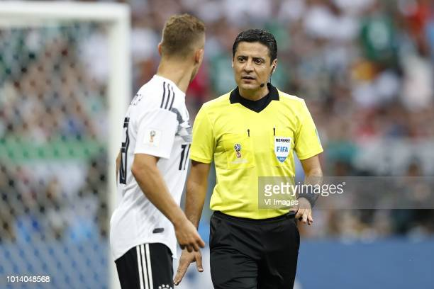 Joshua Kimmich of Germany referee Alireza Faghani during the 2018 FIFA World Cup Russia group F match between Germany and Mexico at the Luzhniki...