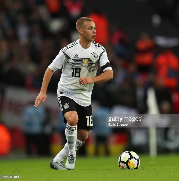 Joshua Kimmich of Germany runs with the ball during the International friendly match between England and Germany at Wembley Stadium on November 10...