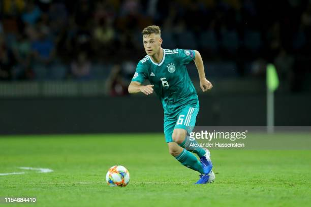 Joshua Kimmich of Germany runs with the ball during the UEFA Euro 2020 qualifier match between Belarus and Germany at BorisovArena on June 08 2019 in...