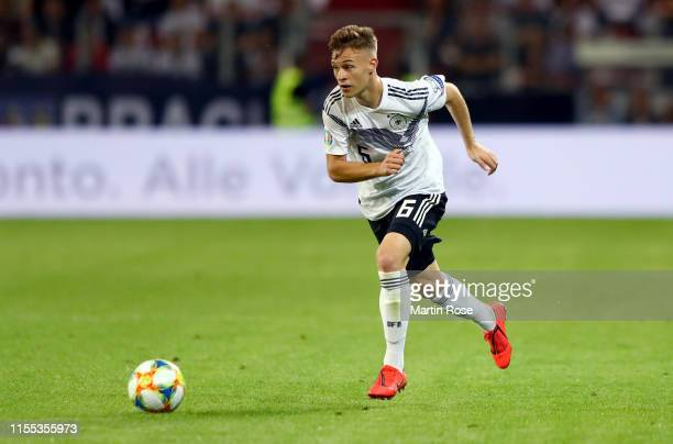 Joshua Kimmich of Germany runs with the ball during the UEFA Euro 2020 Qualifier match between Germany and Estonia at Opel Arena on June 11 2019 in...