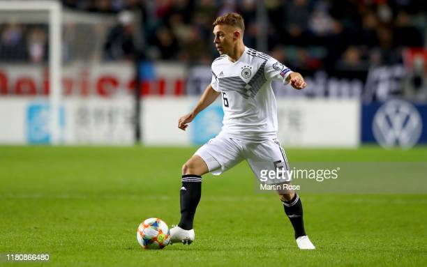 Joshua Kimmich of Germany runs with the ball during the UEFA Euro 2020 qualifier between Estonia and Germany at A.Le Coq Arena on October 13, 2019 in...