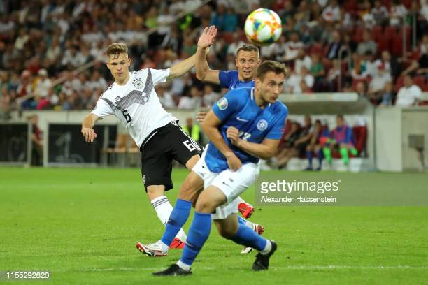 Joshua Kimmich of Germany shoots during the UEFA Euro 2020 Qualifier match between Germany and Estonia at Opel Arena on June 11, 2019 in Mainz,...