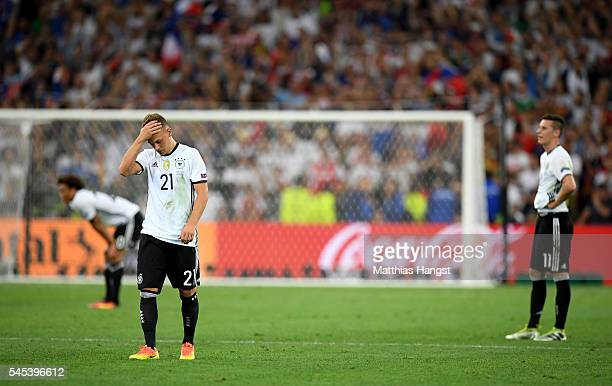 Joshua Kimmich of Germany shows his dejection after his team's defeat in the UEFA EURO semi final match between Germany and France at Stade Velodrome...