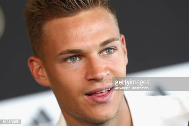 Joshua Kimmich of Germany talks to the media during a press conference of the German National team at MercedesBenzMuseum on August 30 2017 in...