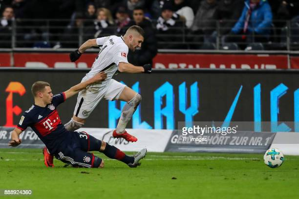 Joshua Kimmich of Muenchen and Ante Rebic of Frankfurt battle for the ball during the Bundesliga match between Eintracht Frankfurt and FC Bayern...