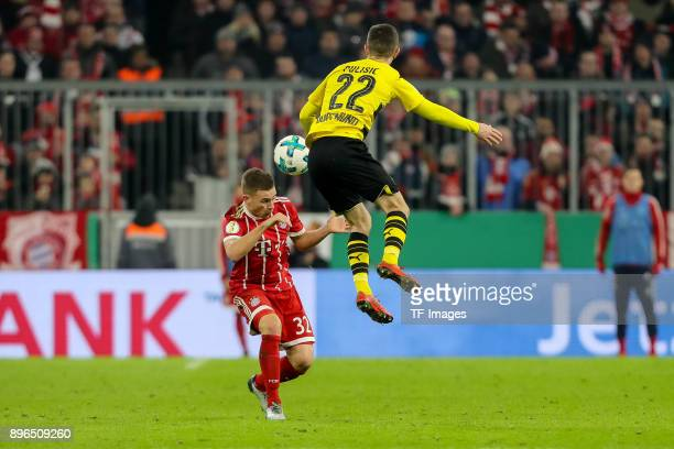 Joshua Kimmich of Muenchen and Christian Pulisic of Dortmund battle for the ball during the DFB Cup match between Bayern Muenchen and Borussia...
