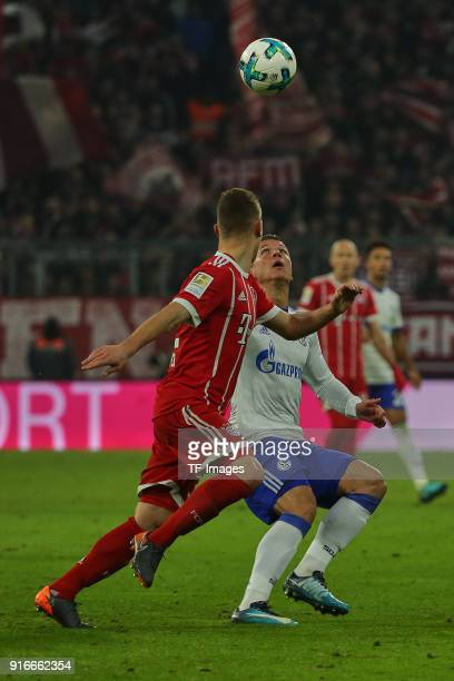 Joshua Kimmich of Muenchen and Yevhen Konoplyanka of Schalke battle for the ball during the Bundesliga match between FC Bayern Muenchen and FC...