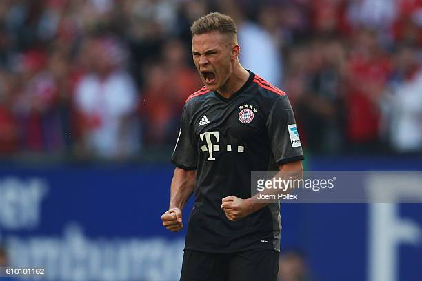 Joshua Kimmich of Muenchen celebrates after scoring his team's winning goal during the Bundesliga match between Hamburger SV and Bayern Muenchen at...