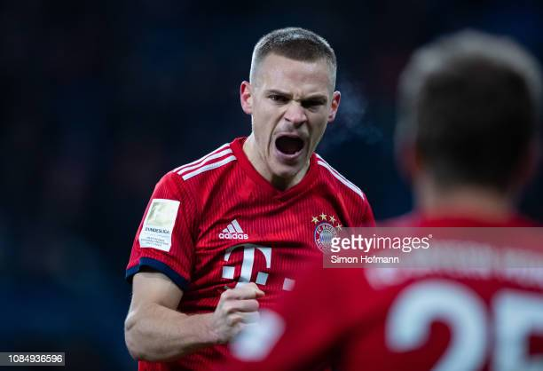 Joshua Kimmich of Muenchen celebrates his team's third goal during the Bundesliga match between TSG 1899 Hoffenheim and FC Bayern Muenchen at...