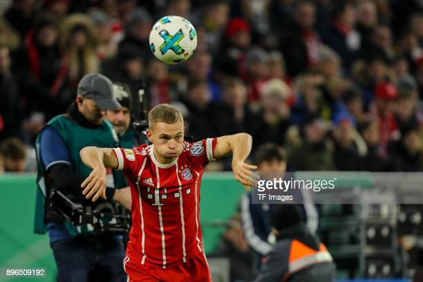 Joshua Kimmich of Muenchen controls the ball during the DFB Cup match between Bayern Muenchen and Borussia Dortmund at Allianz Arena on December 20...