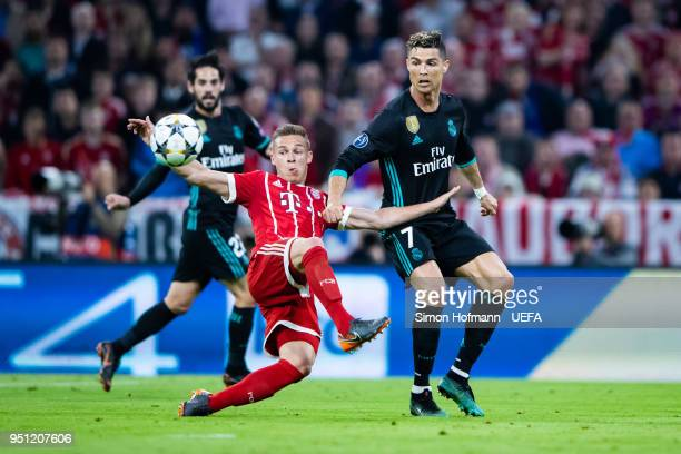 Joshua Kimmich of Muenchen is challenged by Christiano Ronaldo of Madrid the UEFA Champions League Semi Final First Leg match between Bayern Muenchen...