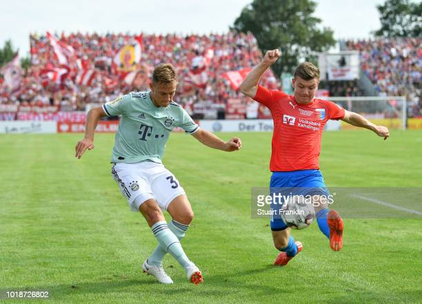Joshua Kimmich of Muenchen is challenged by Jasper Goo§en of Drochtersen during the DFB Cup first round match between SV DrochtersenAssel and Bayern...