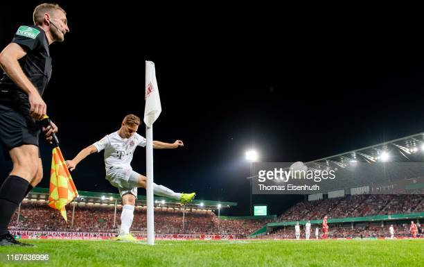 Joshua Kimmich of Muenchen kicks a corner during the DFB Cup first round match between Energie Cottbus and FC Bayern Muenchen at Stadion der...