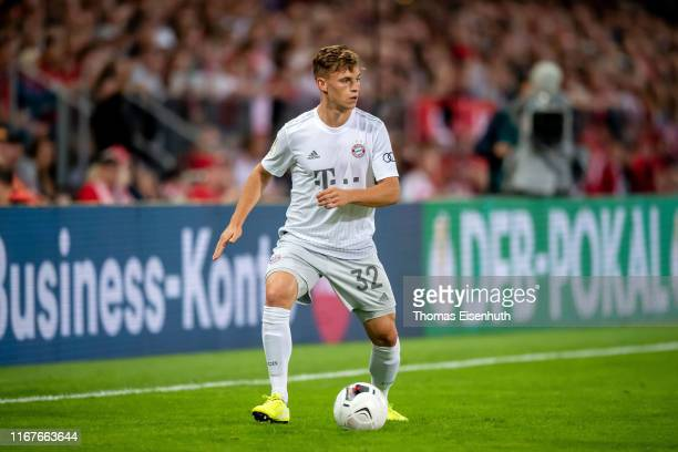 Joshua Kimmich of Muenchen plays the ball during the DFB Cup first round match between Energie Cottbus and FC Bayern Muenchen at Stadion der...
