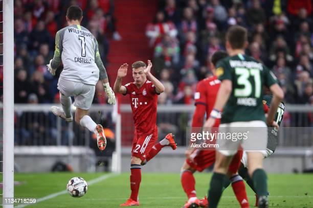 Joshua Kimmich of Muenchen scores his team's fifth goal past goalkeeper Koen Casteels of Wolfsburg during the Bundesliga match between FC Bayern...