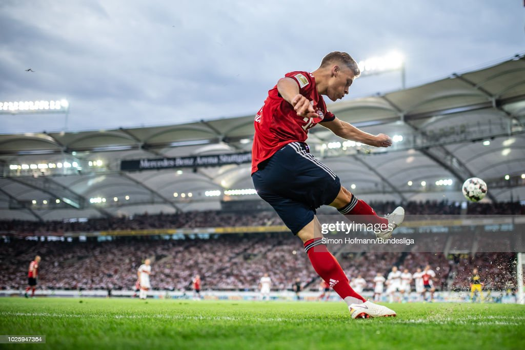 Joshua Kimmich of Muenchen takes a corner kick during the Bundesliga match between VfB Stuttgart and FC Bayern Muenchen at Mercedes-Benz Arena on September 1, 2018 in Stuttgart, Germany.