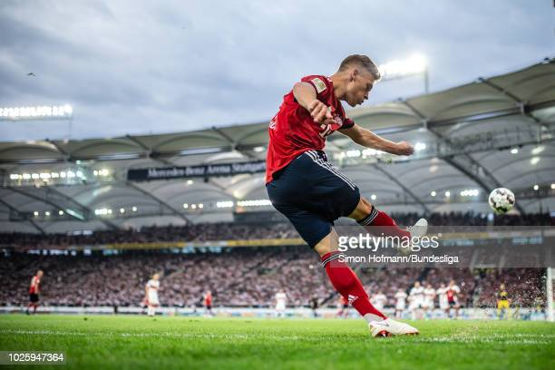 Joshua Kimmich of Muenchen takes a corner kick during the Bundesliga match between VfB Stuttgart and FC Bayern Muenchen at MercedesBenz Arena on...