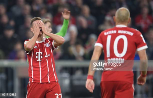 Joshua Kimmich of Munich gestures after missing an opportunity to score during the German Bundesliga soccer match between FC Bayern Munich and VfL...