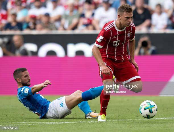 Joshua Kimmich of Munich gets separated from the ball by Dries Mertens of Naples during the Audi Cup SSC Naples vs Bayern Munich match at the Allianz...